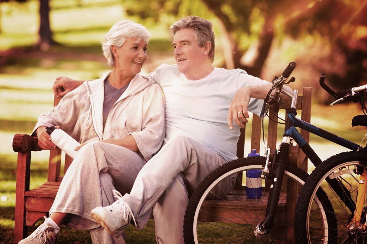 Older Couple Bench Bikes 1280x853